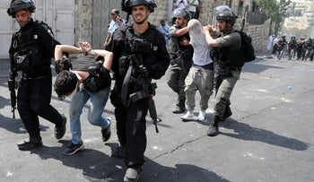 Israeli security forces arrest Palestinian men following clashes outside Jerusalem's Old city July 21, 2017. REUTERS/Ammar Awad