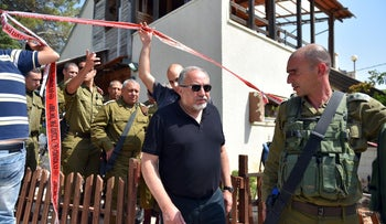 Defense Minister Avigdor Lieberman and IDF chief Gadi Eizenkot at the site of the attack in Halamish, July 22, 2017.