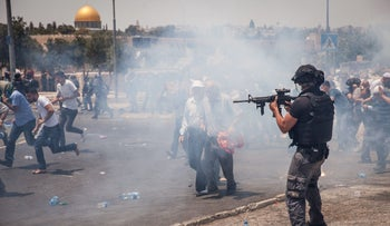 Israeli forces and Palestinian protesters clash in East Jerusalem, July 21, 2017.