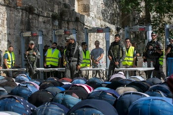 Muslims praying in front of metal detectors outside the Temple Mount in Jerusalem, July 16, 2017.