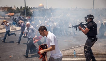 Palestinians and Israeli security forces clash during Friday prayers in the East Jerusalem neighborhood of Ras al-Amud, July 21, 2017.
