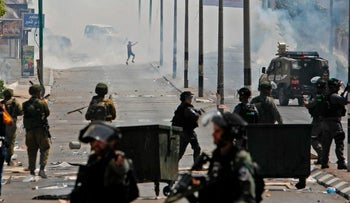 Tear gas fumes billowing during clashes between Palestinian protesters and Israeli forces after Friday prayers at the main entrance of the West bank city of Bethlehem on July 21, 2017 at a protest against new Israeli security measures implemented at Al-Aqsa mosque complex, known to Jews as the Temple Mount, in Jerusalem.