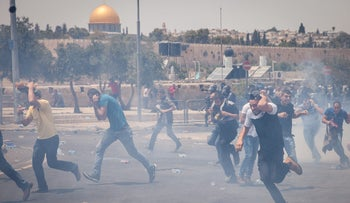 Palestinians clashing with Israeli security forces near Jerusalem's Old City, July 21, 2017.