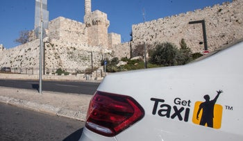 FILE PHOTO: A Gett cab, formerly known as GetTaxi, in Jerusalem