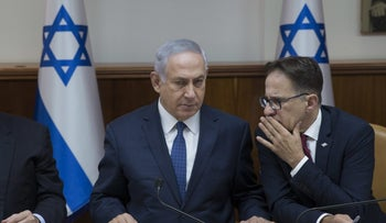 Prime Minister Netanyahu, center, with his cabinet secretary
