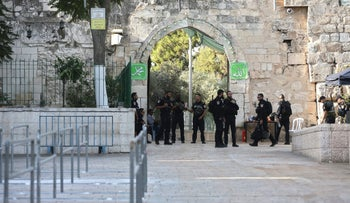 Israeli police officers at one of the entrances to the Temple Mount on Tuesday after the metal detectors were removed.
