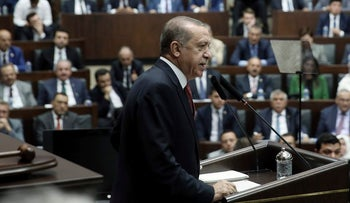 Turkey's President and the leader of ruling Justice and Development Party Recep Tayyip Erdogan addresses his supporters at the parliament in Ankara, Turkey, Tuesday, July 25, 2017.