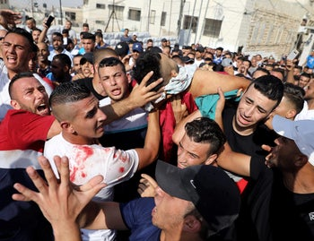 Mourners react as they carry the body of Palestinian Mohammad Abu Ghannam during his funeral in the East Jerusalem neighbourhood of A-Tur July 21, 2017.
