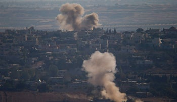 Smoke rises from fighting between forces loyal to Syrian President Bashar Assad and rebels in the village of Jubata al-Khashab as seen from the Israeli-controlled Golan Heights on Sept. 11, 2016.