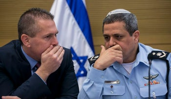 Public Security Minister Gilad Erdan and Police Commissioner Roni Alsheich.
