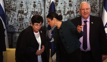 (From left) Supreme Court President Miriam Naor, Justice Minister Ayelet Shaked and President Reuven Rivlin at the judges' swearing-in ceremony, Apr. 13, 2016, in Jerusalem. In the picture, Shaked is turned toward Naor as if to speak to her privately, while Rivlin looks straight into the camera.