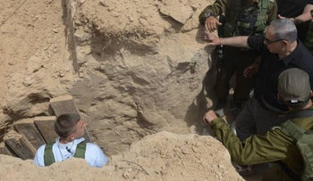 Prime Minister Benjamin Netanyahu and IDF commanders visiting a Hamas-dug tunnel on Israel's border with the Gaza Strip, in May, 2016.