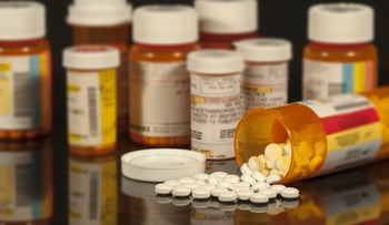 Prescription drugs: Stock photo showing bottles of prescription medications.