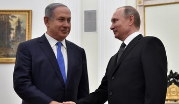 Russian President Vladimir Putin shakes hands with Prime Minister Benjamin Netanyahu during a meeting at the Kremlin, Moscow, Russia, April 21, 2016.