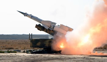A picture released by the official Syrian Arab News Agency (SANA) on December 20, 2011 shows a missile being launched during military exercise by the Syrian army.