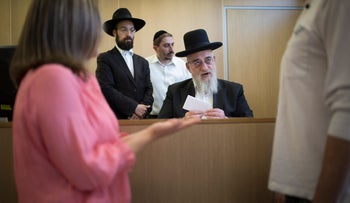 An illustrative image of a religious couple asking for a divorce at a rabbinical court, June 1, 2015.