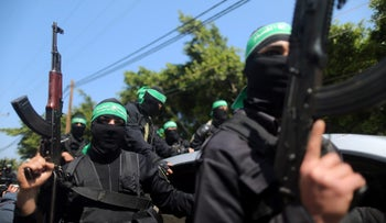 Members of Hamas' military wing taking part in the funeral of senior militant Mazen Fuqaha, in Gaza City, March 25, 2017.