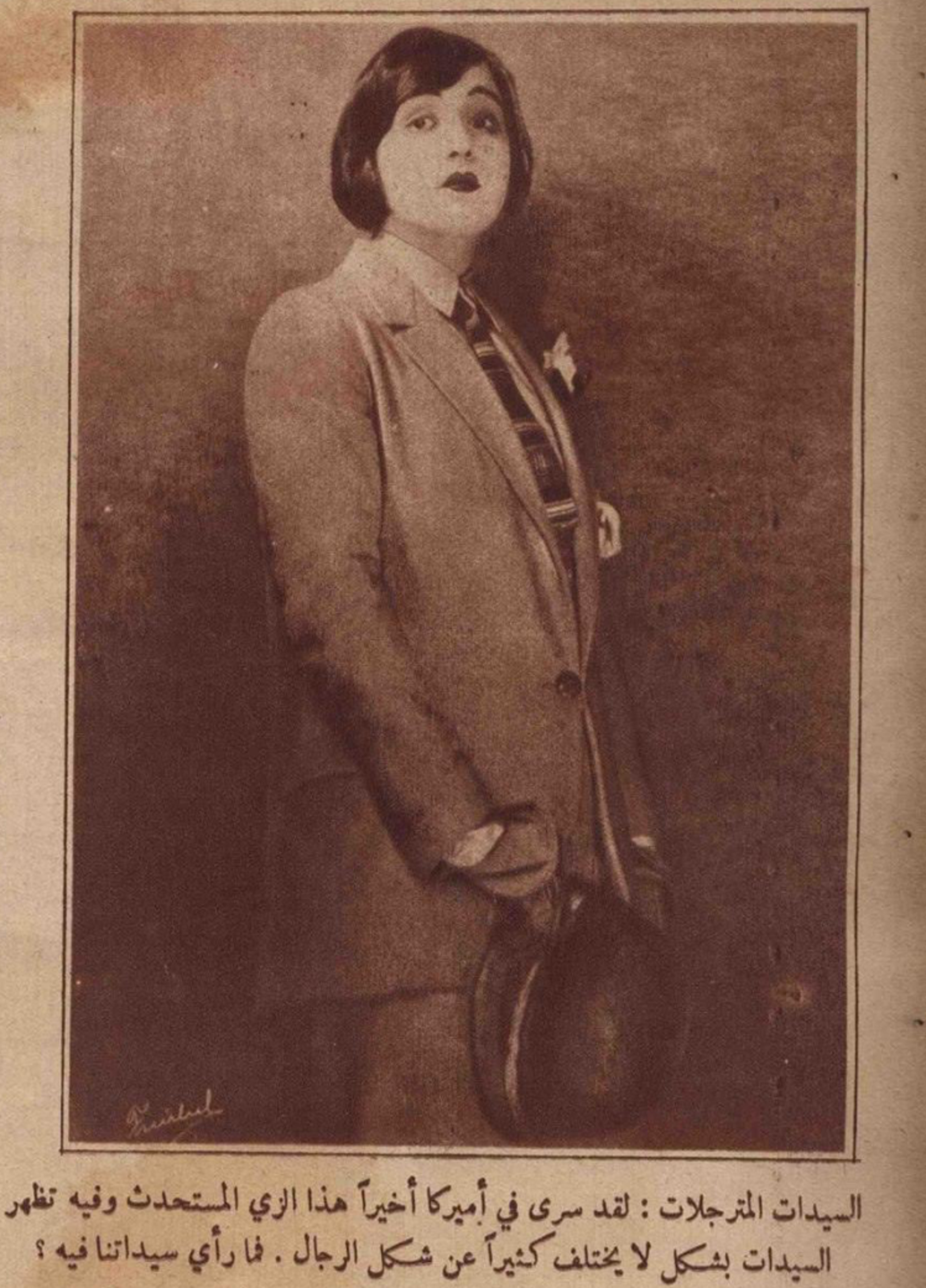 An Egyptian woman dressed as a man in a 1925 magazine article on the trend for women to dress as men.