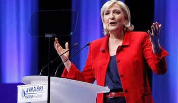 Far-right Presidential candidate Marine Le Pen delivers a speech during a meeting in Lille, northern France, Sunday, March 26, 2017.