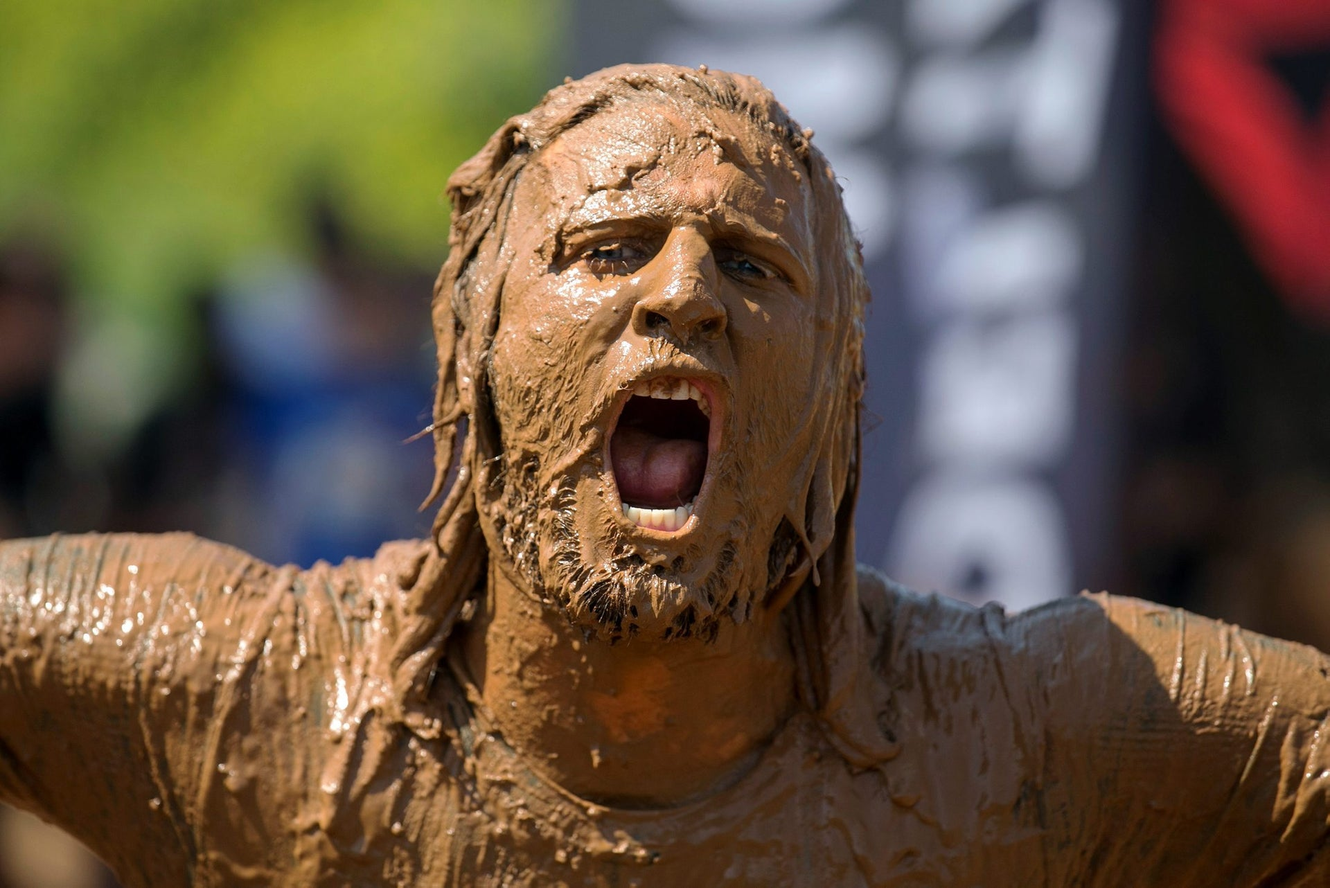 A participant takes part in the first Mud Day Israel obstacle course race in Tel Aviv, Israel March 24, 2017.