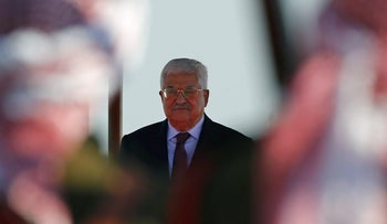 Palestinian President Mahmoud Abbas stands on podium during a reception ceremony in Amman, Jordan March 28, 2017.