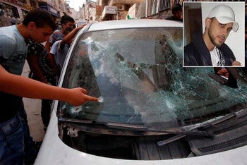 Mustafa Nimr and the car police opened fired at in Shuafat refugee camp, Jerusalem, September 5, 2016.