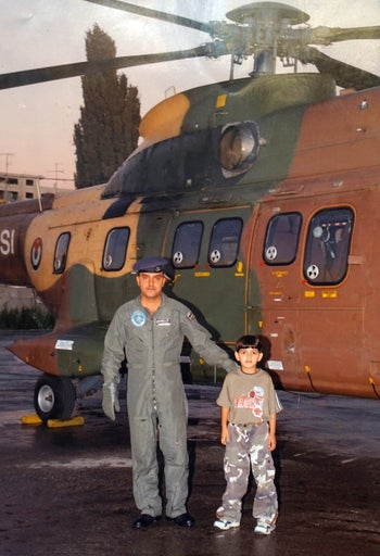 Muhammad Mahmoud Ibrahim al-Hattab as a boy, at the the Muqata, with a helicopter pilot.