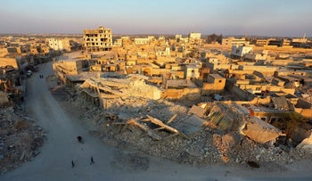 An aerial view shows destruction in al-Bab on March 29, 2017 a month after Turkish-backed rebels recaptured the northern Syrian town from ISIS group fighters.