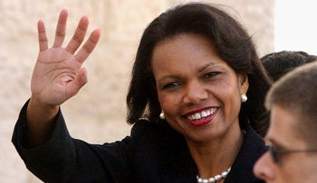 Condoleezza Rice waves as she arrives at the Palestinian Authority headquarters, for a meeting with Palestinian President Mahmoud Abbas in the West Bank town of Ramallah on Monday, Nov.14 2005.