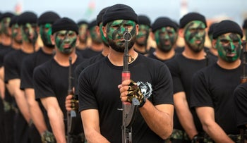 Members of the Palestinian Hamas security forces march during a graduation ceremony in Gaza City on March 30, 2017.
