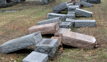 Toppled Jewish headstones in a similar vandalism attack on Jewish cemetery in Missouri, U.S. February 21, 2017.