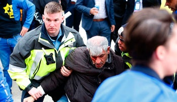 Police helping a protester during clashes between demonstrators at the AIPAC policy conference in Washington, D.C., March 26, 2017.