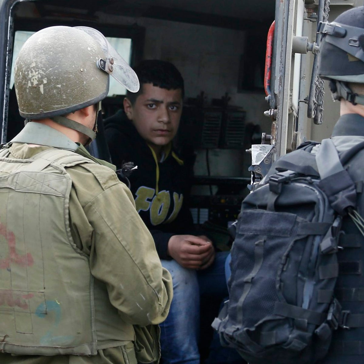 Israeli border police arrest a young Palestinian during clashes following a protest over a Palestinian militant Basil al-Araj, killed by Israeli forces early Monday, in front of the Israeli Ofer prison, near the West Bank city of Ramallah,, Tuesday, March 7, 2017.