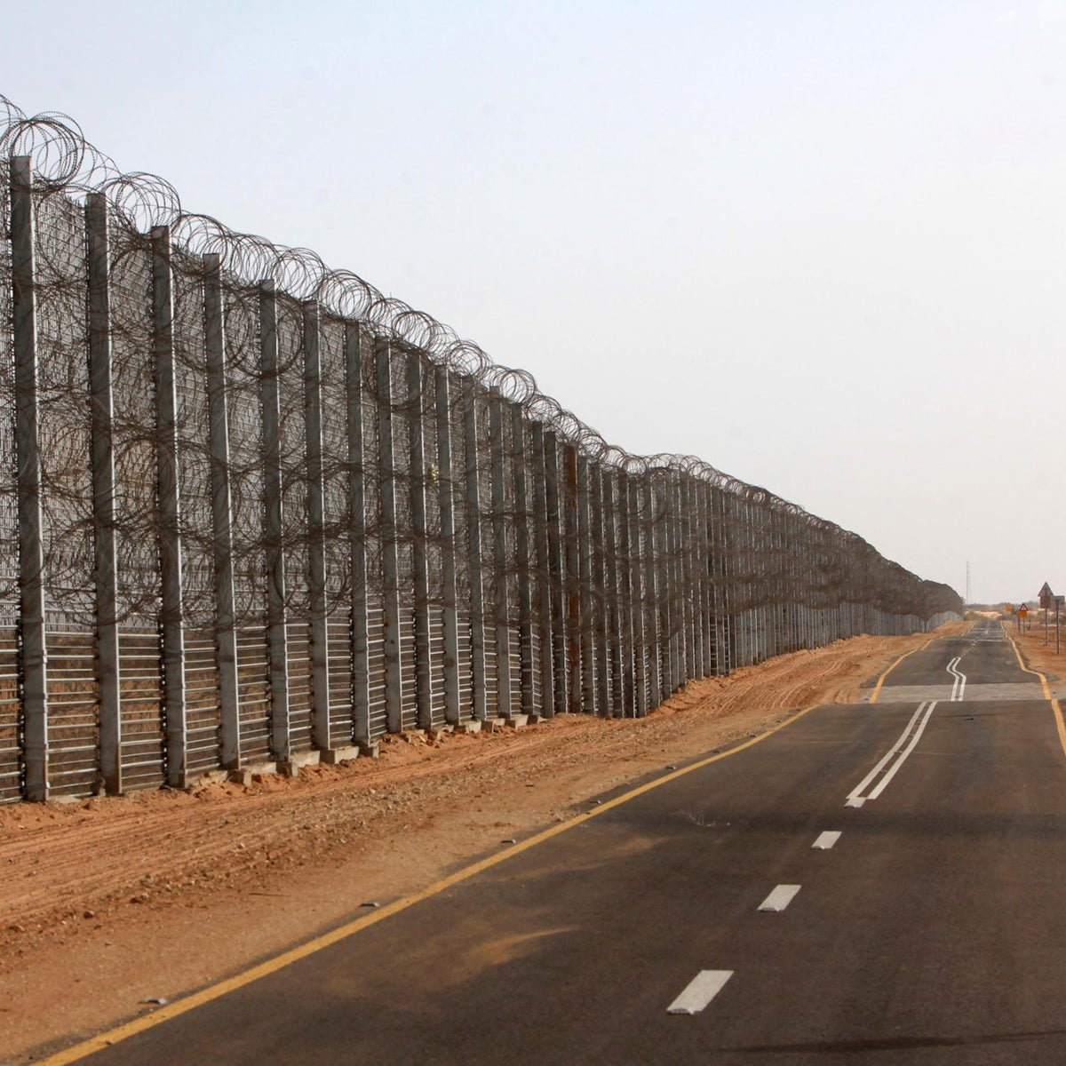 The large metal barrier that protects 30 kilometers of the Israeli-Jordanian border.