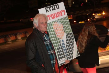 A demonstrator at a Tel Aviv rally protesting the decision to close Kan's news division, April 1, 2017