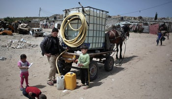 A Palestinian man sells drinking water in Khan Younis refugee camp, southern Gaza Strip. Poor sewage has damaged Gaza's limited fresh water supplies.