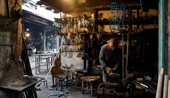 A man works in his shop in a back alley of Sur, in southeastern Turkey. March 10, 2017.