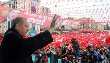 Turkey's President Recep Tayyip Erdogan addresses his supporters during a rally in his hometown, Rize, Monday, April 3, 2017.