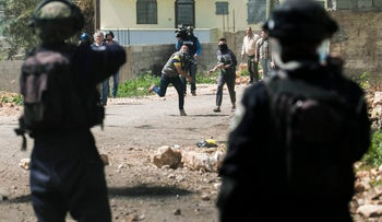 Israeli security forces taking position during clashes with Palestinian protesters in the West Bank, March 31, 2017.