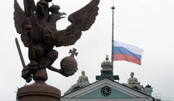 The Russian flag flies at half-mast on top of the State Hermitage museum in central Saint Petersburg on April 4, 2017.