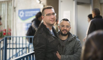 Daniel Marom, left, and Yonatan Marton after receiving ID documents at the Interior Ministry in Ramat Gan listing them as fathers of Tomer, April 4, 2017.