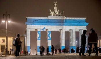 The Brandenburg Gate is illuminated in the colors of the Israeli flag to show solidarity with the victims of a terror attack, January 9, 2017.
