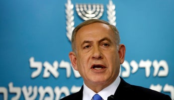 FILE PHOTO: Israeli Prime Minister Benjamin Netanyahu delivers a speech in his office in his Jerusalem office December 28, 2016.