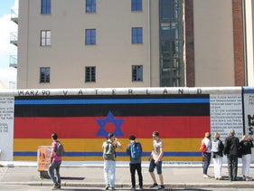 An Israeli flag superimposed over a German one at Berlin's East Side Gallery, an open-air gallery that showcases street art.