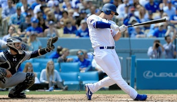 Joc Pederson of the Los Angeles Dodgers connects for a grand slam at Dodger Stadium Opening Day game on April 3, 2017 in Los Angeles, California.