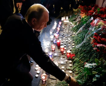 Russian President Vladimir Putin lays flowers at a place near the Tekhnologichesky Institut subway station in St.Petersburg, Russia, Monday, April 3, 2017.