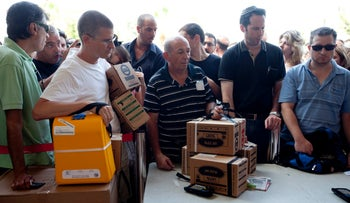 Gas masks being distributed in Tel Aviv, August 2013.