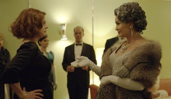 This image released by FX shows Susan Sarandon as Bette Davis and Jessica Lange as Joan Crawford in a scene from, 'Feud: Bette and Joan.'
