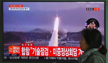 South Korean TV plays file footage of a North Korean missile launch. Seoul, April 5, 2017.