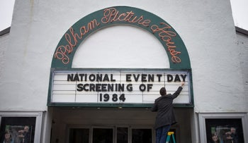 An employee at The Picture House Regional Film Center arranges a sign board ahead of the screening for the movie 1984, in New York, April 4, 2017.